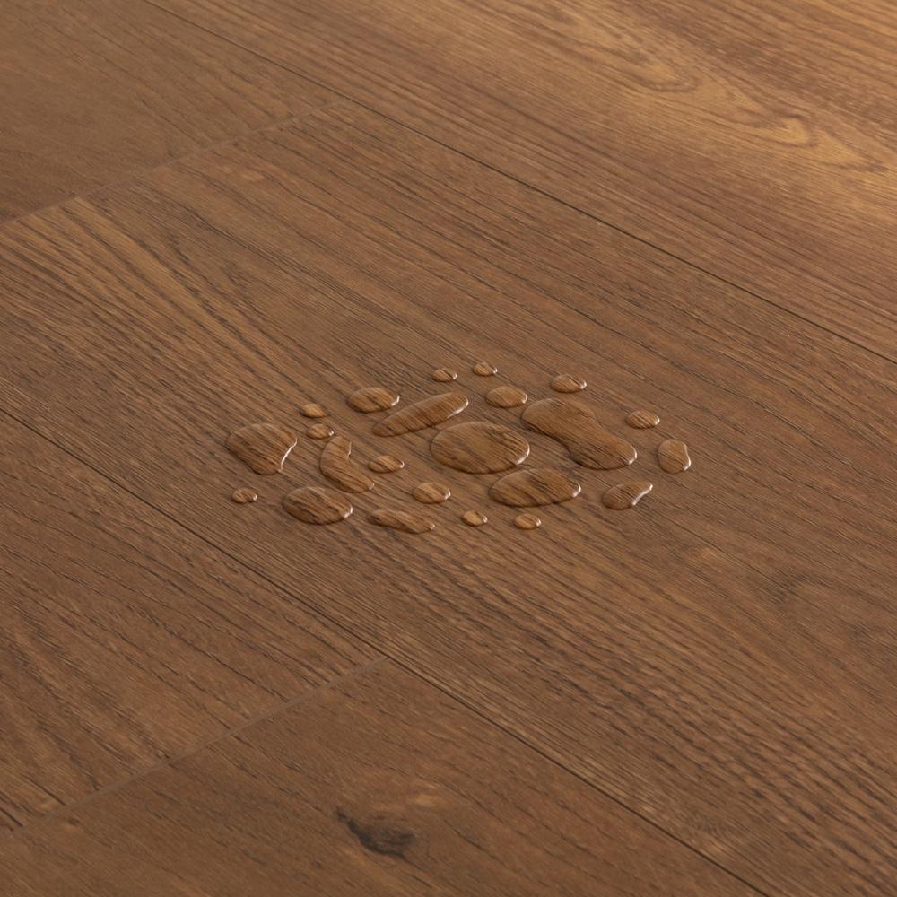 Closeup view of a floor with Copper Oak vinyl flooring installed