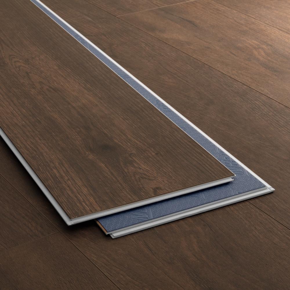 Closeup view of a floor with Chateau Brown - Scratch Resistant Waterproof Floating Floor vinyl flooring installed